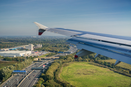 Window view of flying over the highway near Heathrow airport, London, United Kingdom