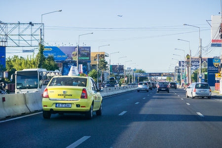 September 14, 2017 Otopeni/Romania - Taxi driving towards the airport