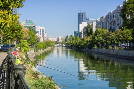 September 14, 2017 Bucharest/Romania - People fishing in Dambovita river near downtown