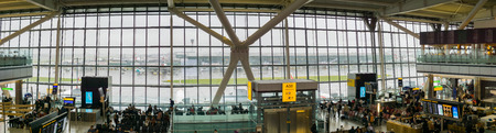 September 9, 2017 London/UK - Panoramic view of Heathrow airport Terminal 5 lounge area and tall windows on a rainy day