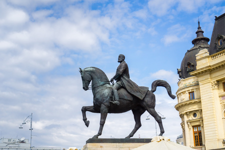 September 22, 2017 BucharestRomania - Equestrian statue of Carol I in front of Biblioteca Centrala Universitara installed in 2007 (the original was taken down by the communism regime in 1947)