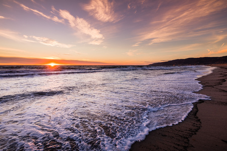Sunset view of Malibu beach, the Pacific Ocean coastline, Los Angeles county, California Stock Photo