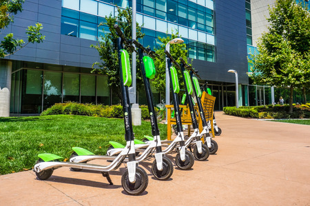 August 9, 2018 Mountain View / CA / USA - Lime Scooters lined up at the LimeHub in the Samsung campus in Silicon Valley, south San Francisco bay area Editorial