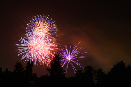 Colorful fireworks display on a dark sky background; Celebrations, Festivals, Independence Day, 4th of July or New Year Stock Photo