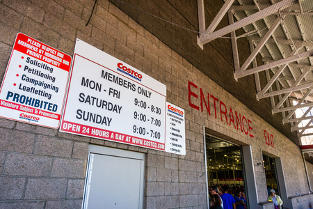 August 6, 2018 Mountain View  CA  USA - Entrance  Exit to one of the Costco Wholesale supermarkets in south San Francisco bay area; stores hours displayed on the wall Editorial
