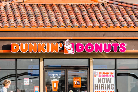 December 17, 2018 Half Moon Bay  CA  USA - Dunkin Donuts sign above the entrance to the location in Half Moon Bay