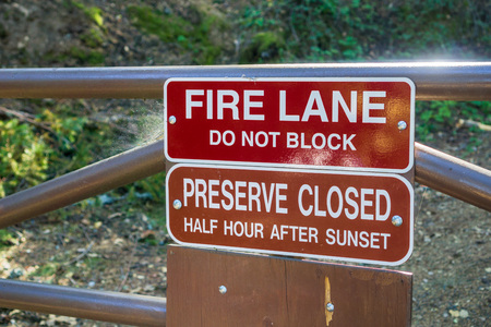 Fire Lane; Do not block and Preserve Closed Half Hour After Sunset signs posted in one of the parks of San Francisco bay area, California