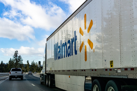 December 27, 2018 Truckee / CA / USA - Walmart truck driving on the interstate through the Sierra mountains Редакционное