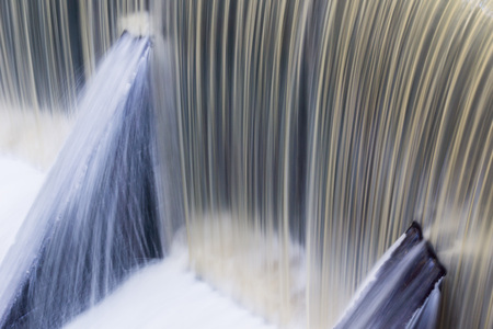 Fast flowing water over a concrete dam, California; long exposure