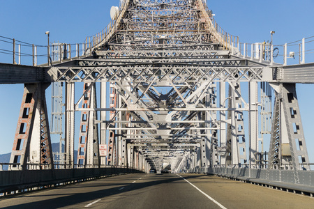 Driving on Richmond - San Rafael bridge (John F. McCarthy Memorial Bridge) on a sunny day, San Francisco bay, California