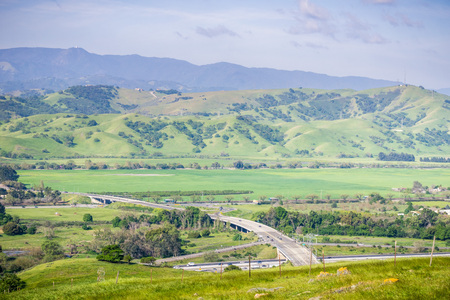 Aerial view of freeway junction and agricultural fields, mountain background, south San Francisco bay, San Jose, California Reklamní fotografie