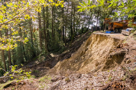 Collapsed paved road due to a landslide as result of heavy rains, San Francisco bay area, California
