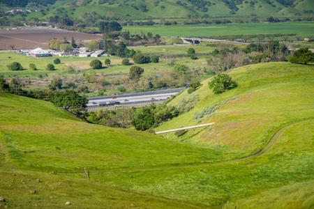 Gas Pipeline going through verdant hills alongside a highway, San Jose, California