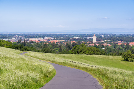 Paved trail on the Stanford dish hill; View towards Stanford campus, Palo Alto, San Francisco bay area, California