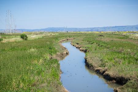 Creek running among the marshes of San Francisco bay, Mountain View, California Stock fotó