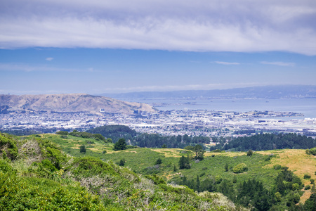 The town of South San Francisco, the Industrial city, as seen from the surrounding hills; San Francisco bay, California