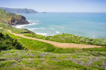 Coastal trail on the green bluffs of Pacific Ocean, Mori Point, Pacifica, California