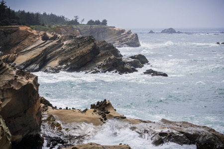 Dramatic shoreline with strange rock formations at Shores Acres State Park, Coos Bay, Oregon