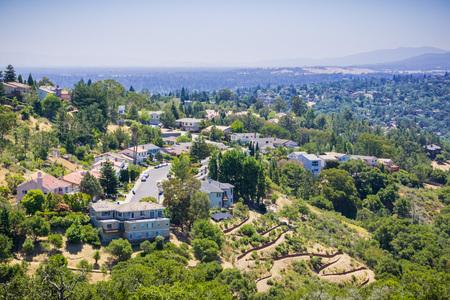 Aerial view of residential neighborhood on top of a hill near Pulgas Ridge OSP, San Carlos, San Francisco bay area, California