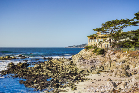 Houses build on the cliffs on the Pacific Ocean, Carmel-by-the-Sea, Monterey Peninsula, California Editorial