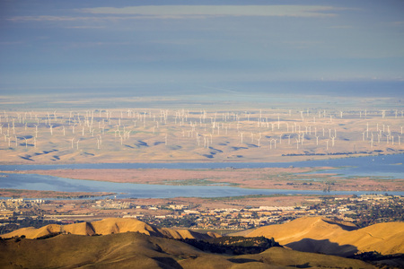 Panoramic view towards San Joaquin river, Pittsburg and Antioch from the summit of Mt Diablo; wind turbines in the background; Mt Diablo SP, Contra Costa county, San Francisco bay area, California Stock Photo