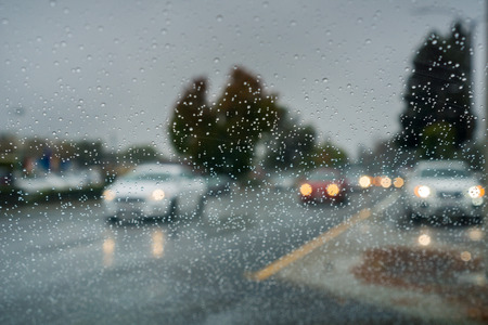 Raindrops on the windshield while driving on a rainy day during fall season, California Banco de Imagens