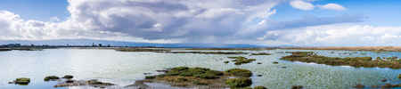 Panoramic view of the Alviso marsh on a stormy day, San Jose, south San Francisco bay, California Imagens