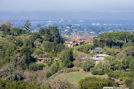 View towards the houses built in Los Altos hills, Mountain View and the San Francisco bay shoreline in the background, California
