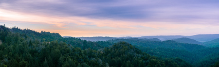 Early morning panorama in Santa Cruz mountains; Monterey bay and the Pacific Ocean visible in the background; San Francisco bay area, California