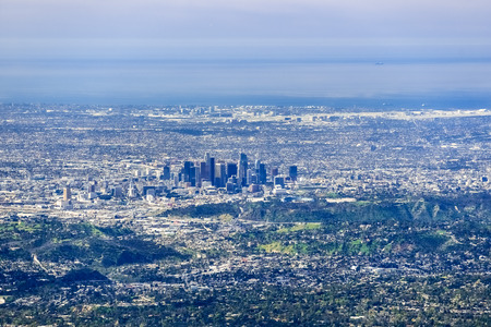 Aerial view of the downtown Los Angeles; LA airport and the Pacific Ocean coastline in the background; south California