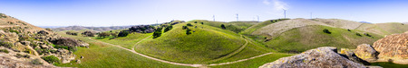 Panoramic view of hills and valleys in the hills of east San Francisco bay area; wind turbines in the background, Contra Costa county, California