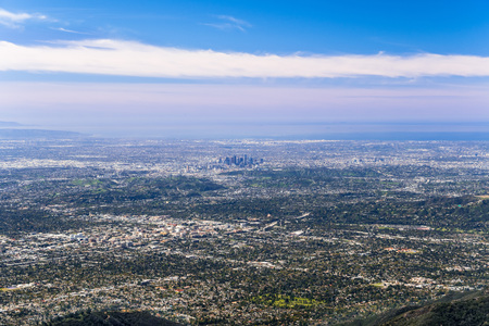 Panoramic aerial view of Los Angeles downtown and the metropolitan area surrounding it; Pasadena in the foreground; Santa Monica and the Pacific Ocean coastline in the background, south California