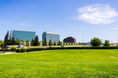 Urban park in Silicon Valley; city skyline in the background; Santa Clara, south San Francisco bay area, California