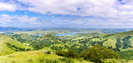 Panoramic view of San Antonio reservoir and the surrounding green hills, Sunol, Alameda county, San Francisco bay area, California
