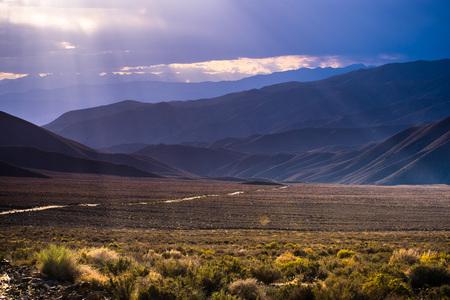 Filtered light illuminating Emigrant Canyon, Death Valley National Park, California