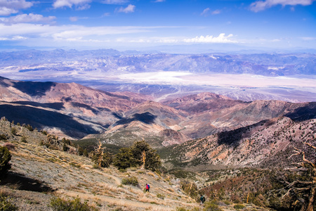 View towards Badwater Basin from the trail to Telescope Peak; hikers in the foreground; Death Valley National Park, California