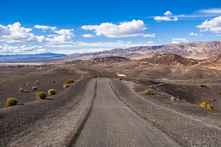 Travelling on an unpaved road through a remote area of Death Valley National Park; Ubehebe crater area in the background; California Stock Photo