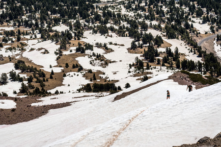 High altitude hiking trail to Lassen Peak still covered in snow on a sunny summer day; Lassen Volcanic National Park, Shasta County, California 写真素材