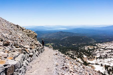 Hiking trail to Lassen Peak; Lassen Volcanic National Park; Lake Almanor visible in the background; Northern California Stock fotó