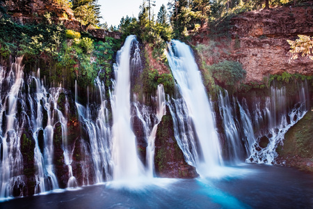 McArthur-Burney falls in Shasta National Forest, north California; long exposure Фото со стока