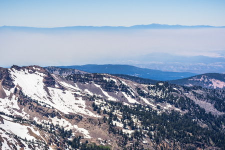 View towards Sacramento Valley and Redding as seen from Lassen Volcanic National Park, smoke from one of the wildfires covering the valley; Northern California