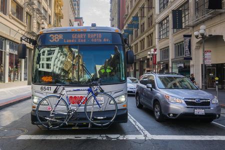 September 5, 2017 San Francisco/CA/USA - Muni bus carrying a bicycle at a traffic stop in downtown San Francisco