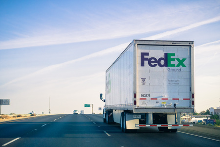 October 15, 2017 Stockton/CA/USA - FedEx Ground truck driving on the freeway on a sunny Sunday morning