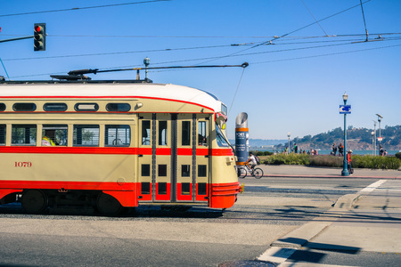 October 7, 2017 San Francisco/CA/USA - Old looking tramway passing by near the Ferry Building Editorial