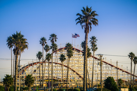 July 8, 2017 Santa CruzCAUSA - The Giant Dipper Roller coaster in Santa Cruz Beach Boardwalk amusement park at sunset, California