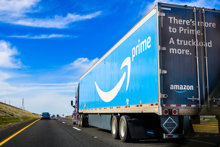 March 19, 2018 Kettleman City  CA  USA - Amazon truck driving on the interstate, the large Prime logo printed on the side