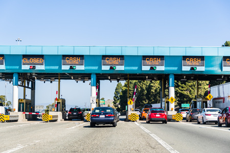 April 14, 2018 Vallejo / CA / USA - Cars stopping at Carquinez Bridge Toll Plaza to pay for the use of the bridge of eastbound traffic; north San Francisco bay area