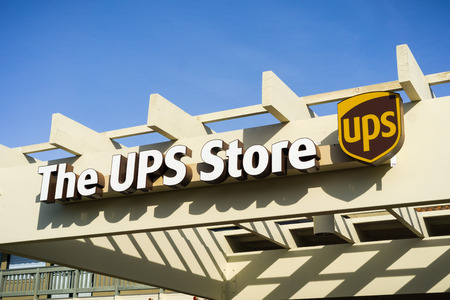 December 22, 2017 Sunnyvale / CA / USA - The UPS store logo placed above the to one of their Santa Clara county locations, San Francisco bay area Reklamní fotografie - 116398442
