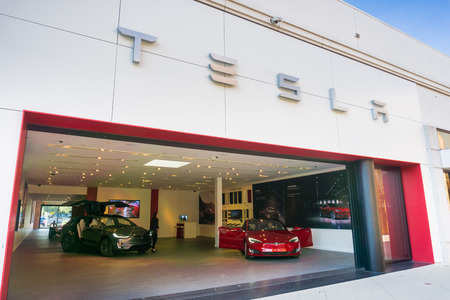 December 7, 2017 Palo Alto  CA  USA -  Tesla showroom displaying Tesla Model S and Tesla Model X, located in the upscale open air Stanford Shopping Mall, Silicon Valley, California