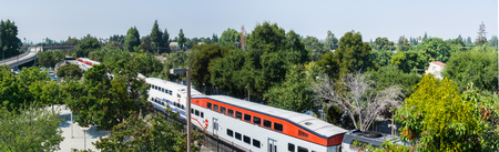 September 5, 2017 SunnyvaleCAUSA - Aerial view of a Caltrain in south San Francisco bay Redakční